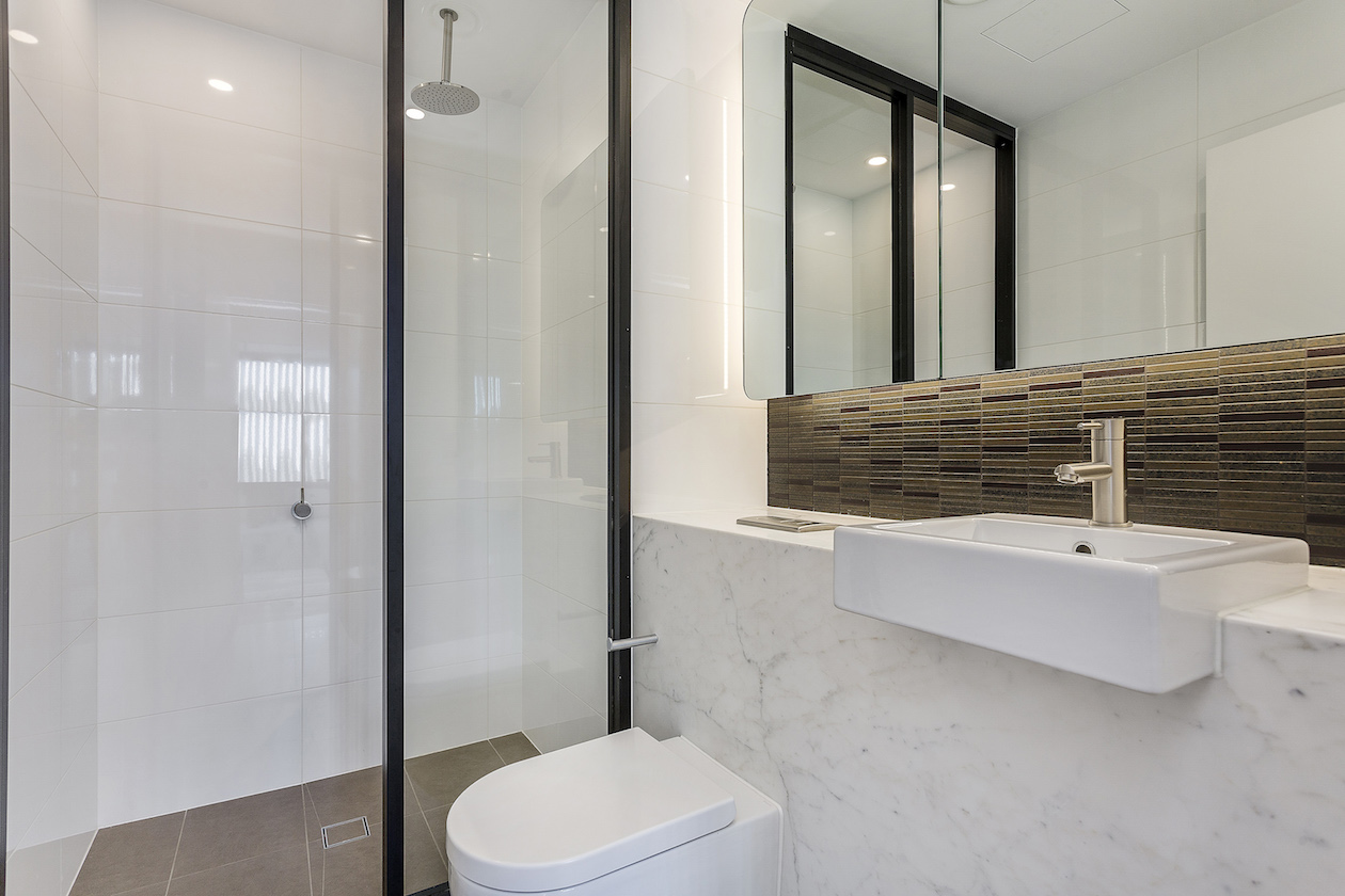 https://www.stone-tech.com.au/wp-content/uploads/Dark-bathroom-1.jpg